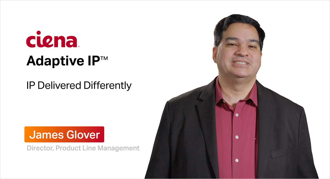 Man talking with Adaptive IP at the background